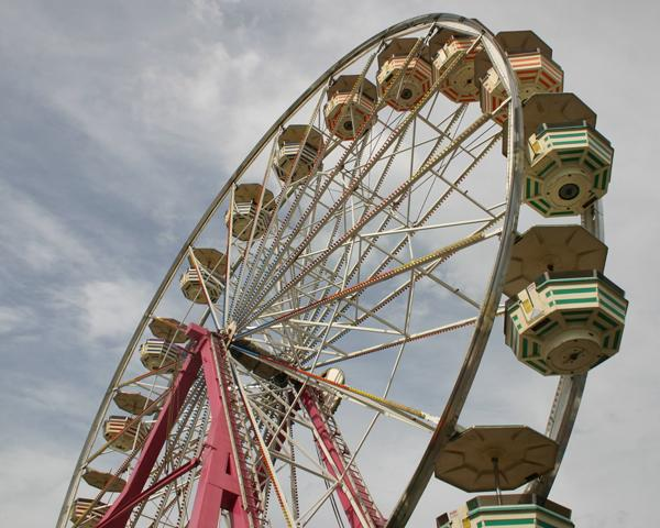 A Ferris wheel towers over the fairgrounds Saturday night.