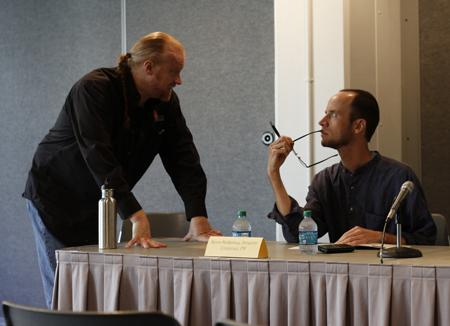 Mark von Schlemmer (left) and Kevin McKinney (right), work to plan the roundtable session at the Show Me Justice Film Festival. (Photo submitted)