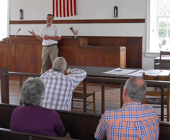 (Photo by Michael Freeman, digitalBURG) Mike Shaw discusses writing a chapter for a new biography of Blind Boone during a Johnson County Historical Society meeting Sunday in the historic courthouse on Main Street.