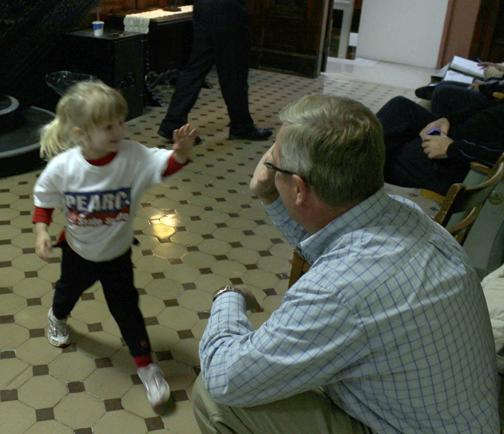 (Photo by Andy Lyons, digitalBURG) State Sen. David Pearce gets a victory high-five from a little supporter, Mallory Hall, at the Johnson County Courthouse Tuesday night.