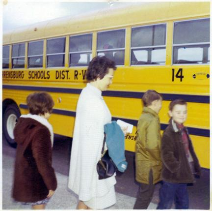 (Courtesy photo) Lisa's mother, Elizabeth Irle, escorts children onto a bus for what Lisa thinks was a field trip.