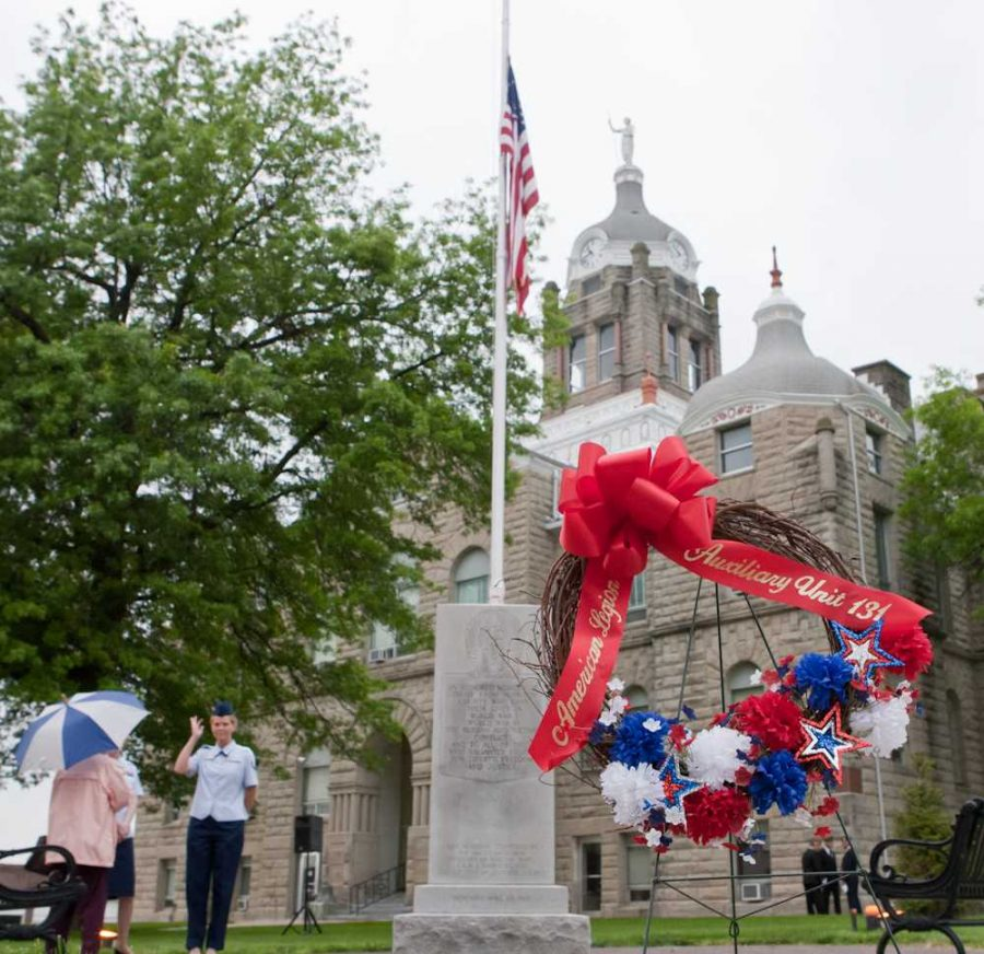 Members+of+the+Warrensburg+American+Legion+gather+at+the+Johnson+County+Courthouse+on+Holden+Street+for+a+reading+of+the+names+of+fallen+soldiers+from+the+stone+marker.+The+ceremony+was+relocated+to+the+American+Legion+building+on+Young+Street+due+to+inclement+weather.+