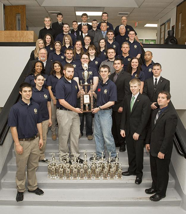 Members+of+the+UCM+Criminal+Justice+team+display+their+numerous+accolades+received+during+the+national+championships.