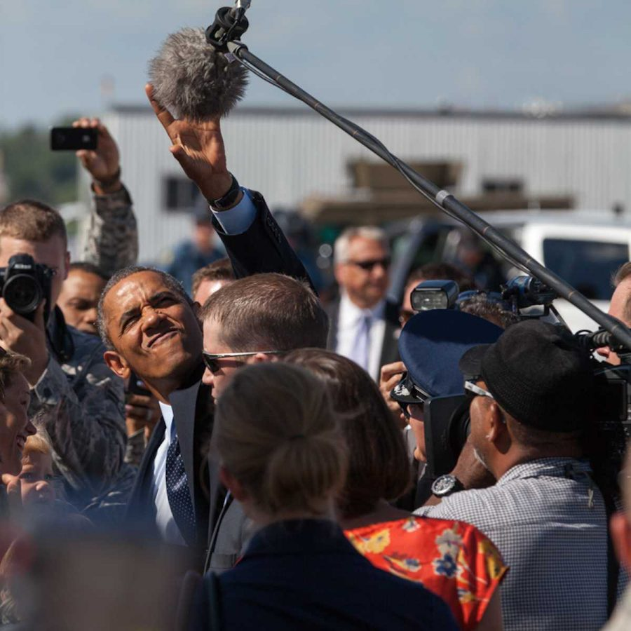 President+Obama+jokingly+reaches+for+a+fuzzy+microphone+after+landing+at+Whiteman.