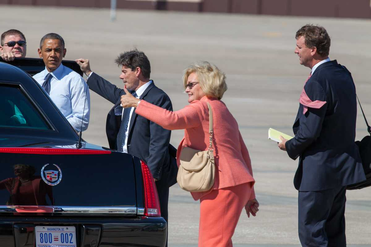 Whiteman+officials+greet+the+president