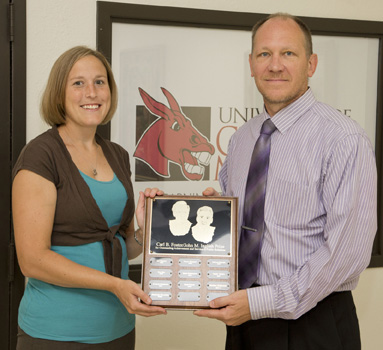 (Courtesy photo) Robin Krause, right, director of marketing and promotions at the University of Central Missouri, recently presented Courtney Niemuth, of Leeton, with the 2013 Carl B. Foster/John M. Inglish Prize in Public Relations. Niemuth is the manager of new media communications in the Office of University Relations at UCM.