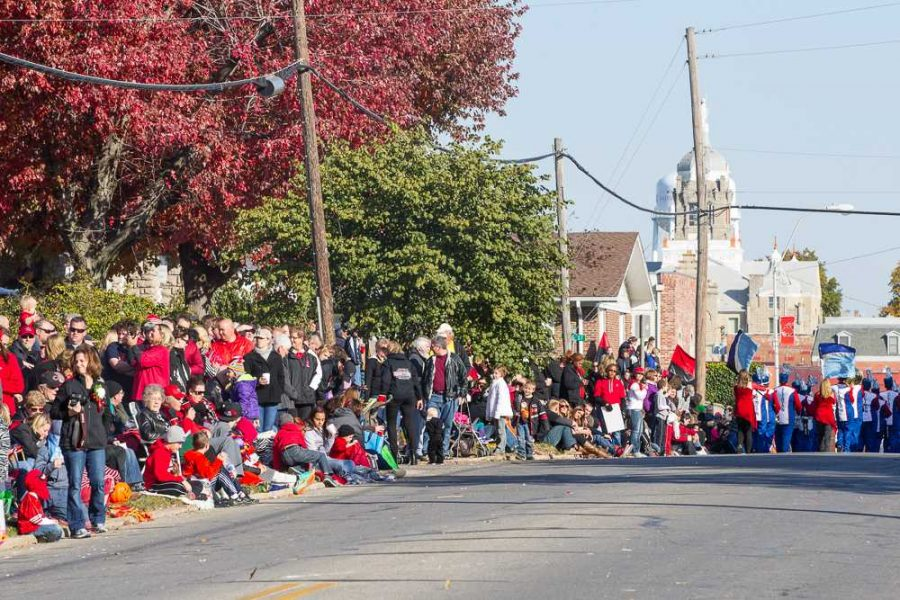 People watch as the parade comes down Holden Street.