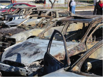 Cars were set on fire at the Auto Buy Credit on West Florissant Avenue in Ferguson, Mo., during a night of protests Monday, Nov. 24.