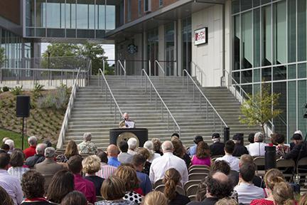 PHOTO BY STEVEN SPEARS / NEWS EDITOR UCM President Chuck Ambrose gives his annual state of the university address Thursday afternoon on the south side plaza of The Crossing - South at Holden.