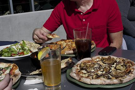 PHOTO BY ALEX AGUEROS / SPORTS EDITOR Spin! Pizza, a new restaurant at the Crossing — South at Holden, offers specialty pizza, alcohol and a patio seat to Mules home football games.