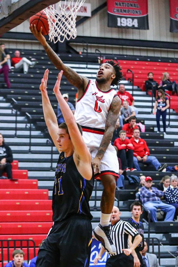 PHOTO SUBMITTED BY UCM PHOTO SERVICES Senior guard D'Marnier Cunningham attempts a layup in a 98-95 overtime loss at home to Nebraska-Kearney on Dec. 19.