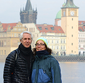 PHOTO SUBMITTED BY ROBERT BRESHEARS Robert Breshears (left) and his wife Karen stand in front of the clock tower on the Vlatava River in Prague, Czech Republic.