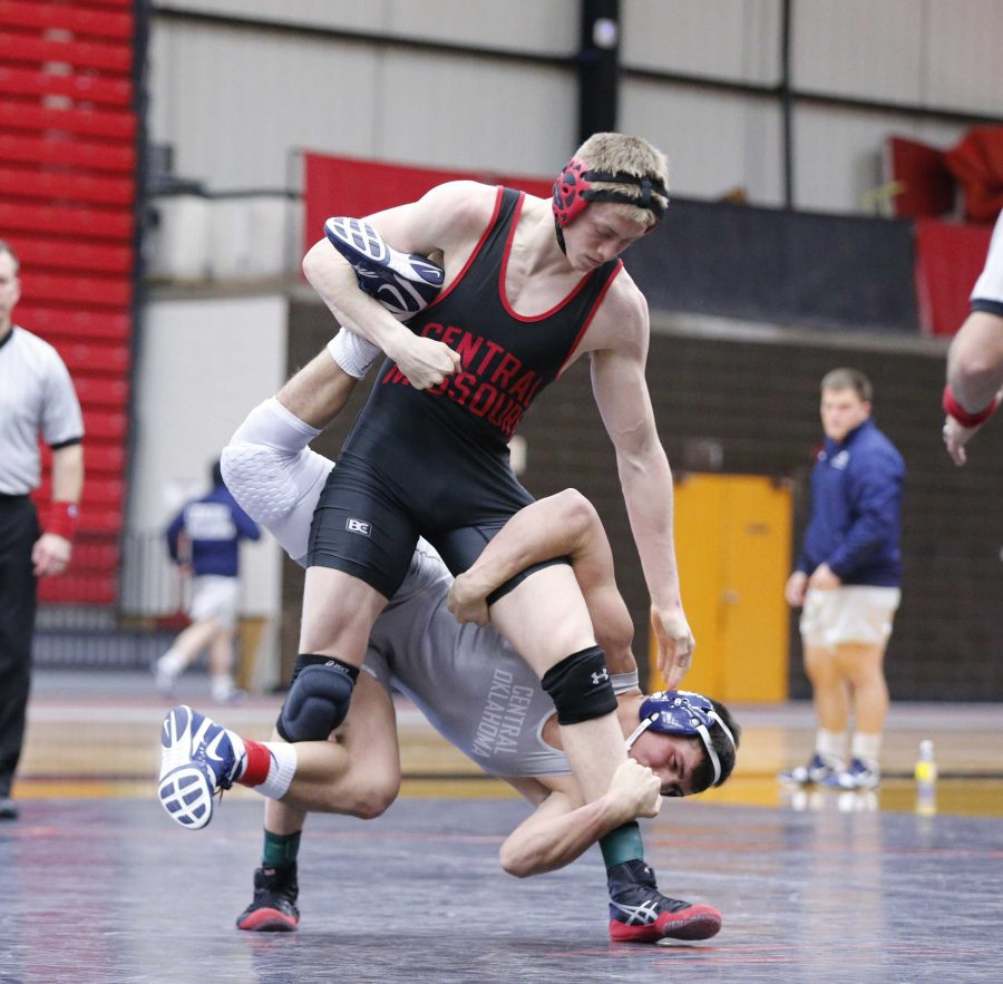 PHOTO SUBMITTED BY UCM ATHLETICS MEDIA RELATIONS / Jesse Reser wrestles Central Oklahoma's Danny Carillo. Reser pinned Carillo at :43, giving the Mules their first points of the dual.
