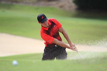 Shayne Allan hits his ball from the bunker in Wednesday's Mule Invitational at the Mule National Golf Course.