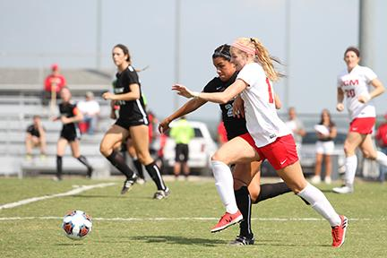Megan Wooley races past an Southwest Oklahoma midfielder to reach the ball.