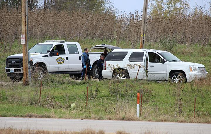 PHOTO BY CHRIS HOLMBERG / REPORTER Missouri State Highway Patrol troopers inspect an SUV that crashed in northeastern Warrensburg Tuesday near the corner of U.S. 50 and Northeast 201 Road. The crash resulted in one arrest and a 4 1/2-hour manhunt for a second suspect, which led troopers to a home where a man was arrested.