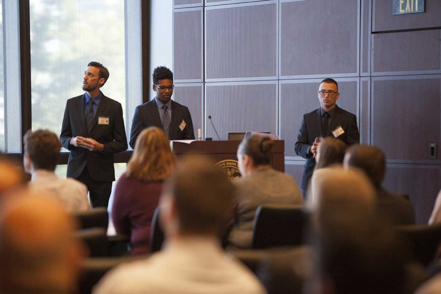 PHOTO SUBMITTED BY BELINDA COPUS  /  Ryan Evans, center, presents the website he helped create with his team Oct. 26 at the Federal Reserve Bank in Kansas City, Missouri.