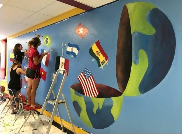 PHOTOS BY GRACE BUSHMEYER / WHS JUNIOR Students work on a new mural in the Warrensburg High School foreign language hallway.