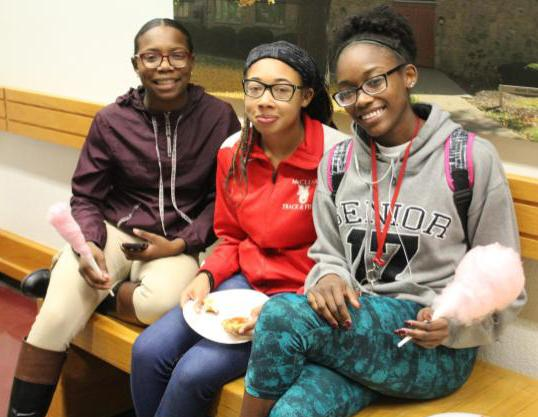 From left, Dahnae Meriwether, Daya Clinton and Destiney Nash sit to eat after grabbing some food. All three are freshmen at UCM.