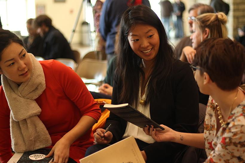 From left, EJ Koh and Amy Meng speak to students after a collaborative poetry reading with the Women, Gender and Sexuality studies Feb. 7 in the James C. Kirkpatrick Library.