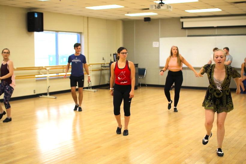 Alyssa Jenkins, far right, leads a tap dancing number to