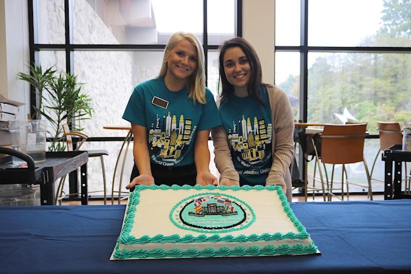 Graduate students Megan Duffey, left, and Adriana Vivas with birthday cake to celebrate the Elliot Student Union's 56th birthday.