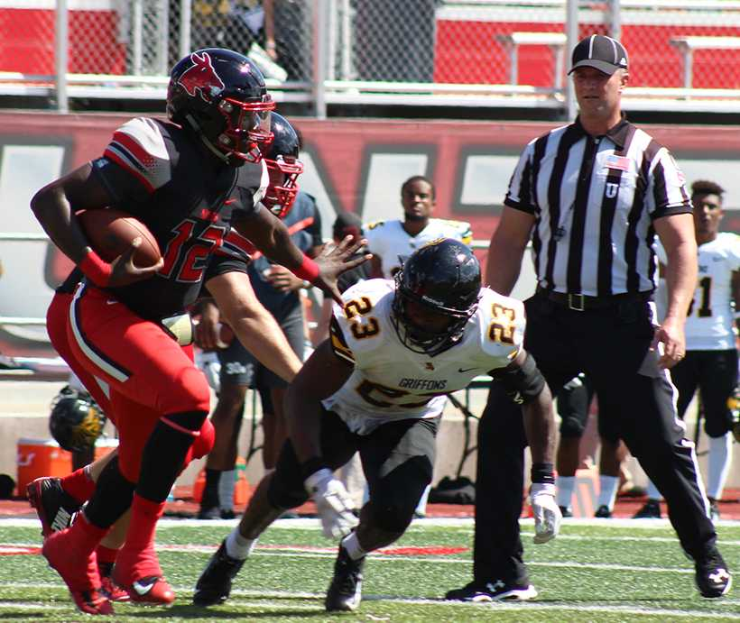 Redshirt freshman quarterback Jeremy Hunt fends off a tackle in the Mules 51-14 victory over Missouri Western Saturday at Walton Stadium.  (Photo by Kaitlin Brothers/News Editor)