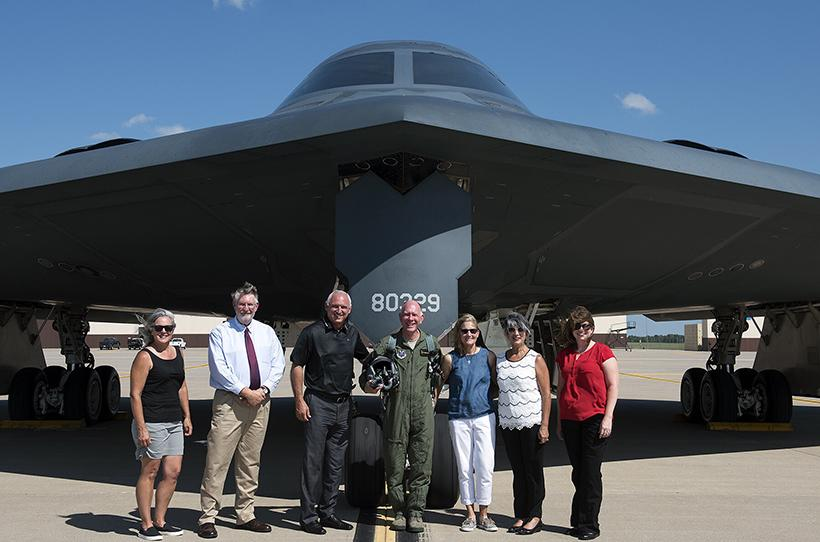 From left to right: Kelly Good, Rich Cole, Jeff Huffman, Chuck Ambrose, Kris Ambrose, Monica Huffman and Kristen Plummer pose in front of the B-2 Stealth Bomber. (Photos submitted by Chuck Ambrose)