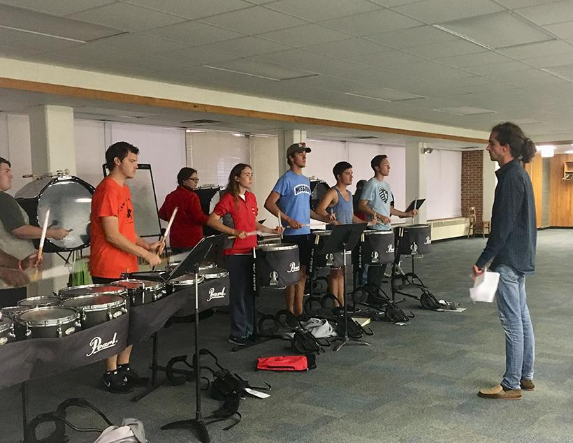 Alex Smith works with the UCM Drumline before marching band rehearsal on Tuesday. (Photo by Erica Oliver/Assistant Photo Editor)