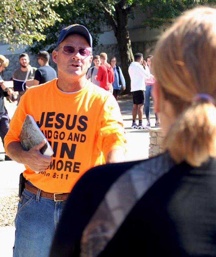 Brother Matthew from Consuming Fire Campus Ministries in Missouri has an exchange with senior political science major Natalia Gunderson. At one point during this exchange he accused Gunderson of being an Antichrist. (Photo by Chris Holmberg / Managing Editor)