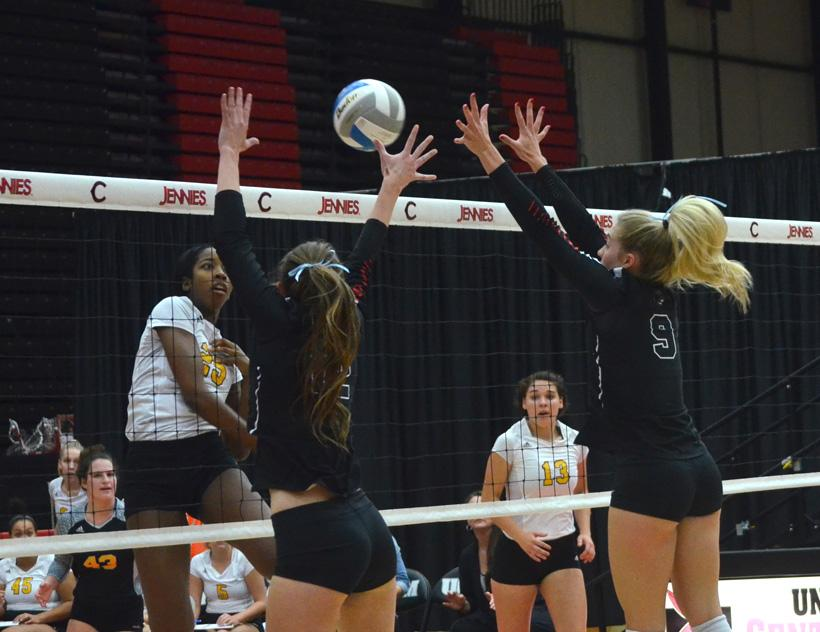 Junior Rylee Neigenfind and sophomore Audrey Fisher attempt to block a hit in the Jennies 3-0 sweep of Fort Hays State Friday at the Multipurpose Building. (Photo by Erica Oliver/Assistant Photo Editor)