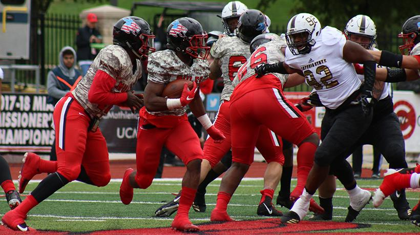 Sophomore running back Devante Turner attempts to run the ball in Central Missouris 41-23 loss to Emporia State Saturday at Walton Stadium/Kennedy Field. (Photo by Molly Burnam/Photo Editor)