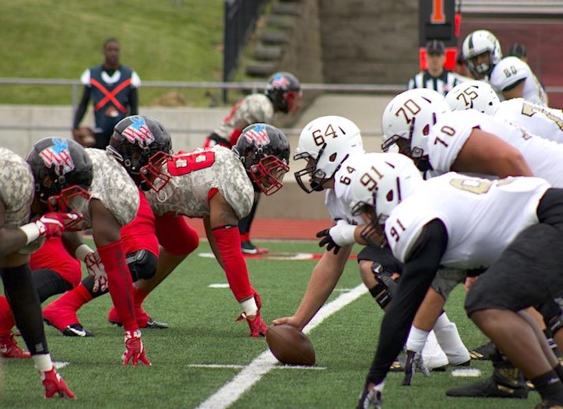The University of Central Missouri's football team wears camouflage with their American flag mule helmets to support the United States Armed Forces while facing Emporia State University. (Photos by Molly Burnam/Photo Editor)