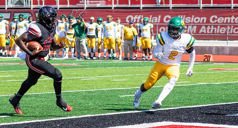 Mules quarterback Jeremy Hunt scores on a 6-yard run in the 61-7 victory over Missouri Southern Saturday at Walton Stadium. (Photo by Peter Spexarth/For the Muleskinner)