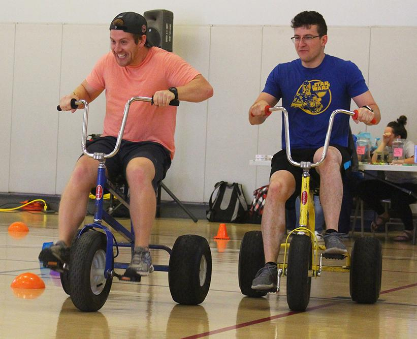 From left, William Hyde, a junior marketing major, and Jordan Klingensmith, a senior aviation major, race each other around the track on the Lower Courts at the Student Recreation and Wellness Center.