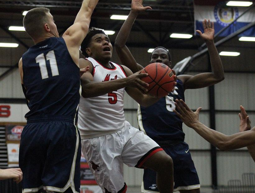 Sophomore guard Daniel Farris goes up for a layup through three defenders in the Mules 77-65 win over Illinois-Springfield Saturday at the Multipurpose Building. Farris finished with five points and five rebounds. (Photo by Jason Brown/Sports Editor)
