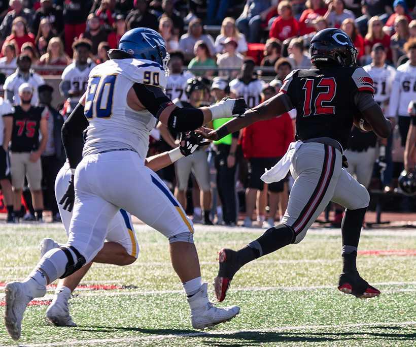 Mules quarterback Jeremy Hunt evades pressure in the Mules 42-35 win over Nebraska-Kearney.(Photo by Peter Spexarth/For the Muleskinner)
