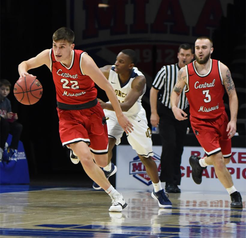 Junior guards Matt Wilkinson (left) and Blake Spellman (right) start a fast break in the Mules loss to Central Oklahoma in the 2018 MIAA Tournament at Municipal Auditorium in Kansas City, Missouri. (Photo by Kristine Hafford/For the Muleskinner)