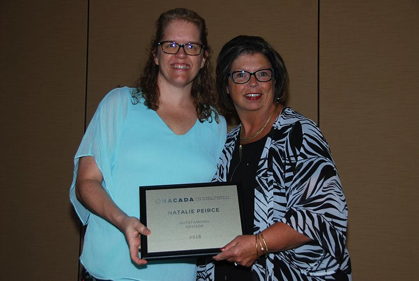 Natalie Peirce (right) posing with the award with Amy Sannes, the 2018 President of NACADA:  The Global Community for Academic Advising on Sept. 30 at the ceremony in Phoenix. (Photo submitted by Natalie Peirce)