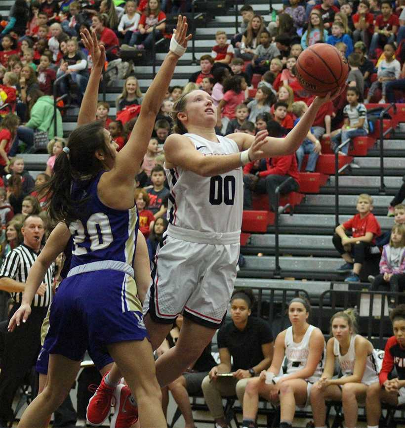 Senior guard Paige Redmond goes up for a layup in the Jennies 86-74 win over Westminster Tuesday at the Multipurpose Building. Redmond scored 13 points in the win and has reached double figures in all but one game this season. (Photo by Jason Brown/Sports Editor)