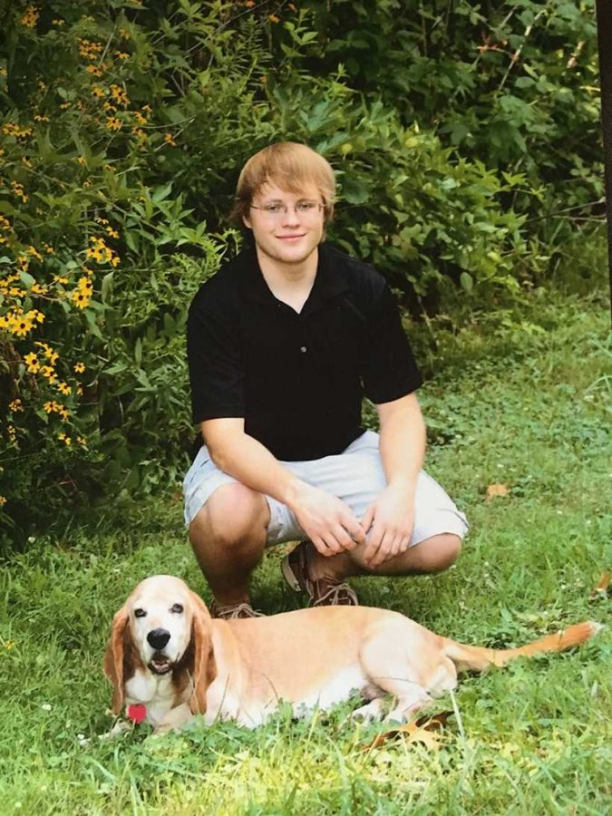 Andrew Pierson poses with his dog at home in Fredericktown, Missouri. (Photo submitted by Colleen Pierson / For the Muleskinner)