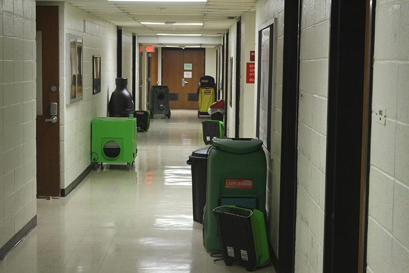 Fans and dehumidifiers hum along in the KMOS-TV hallway after a steam coil malfunctioned in the Highlander Theatre. Photo by Jason Brown/Managing Editor