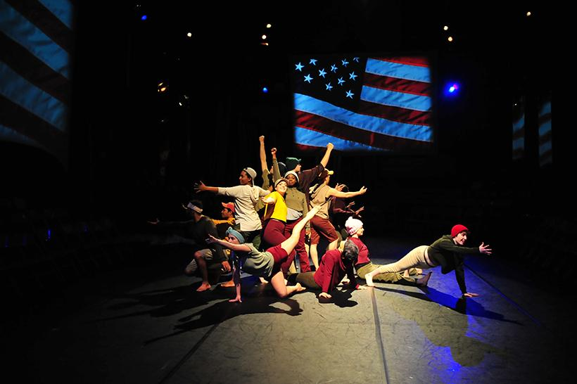 """Photo submitted by Kayla Helms. Spring 2018 cast of """"Step Forward"""" performs the """"Climate Change Dance."""" Carly Othic, with outstretched arms, represents Earth and cast members surrounding her represent humanity."""