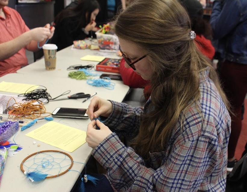 Undergraduate student Marissa Ginger works on her dreamcatcher at the Native American Appreciation event held during Unity Week Feb. 21 at Cafe Rouge in the Elliott Student Union. (Photo by Danielle Friedmeyer/For the Muleskinner)