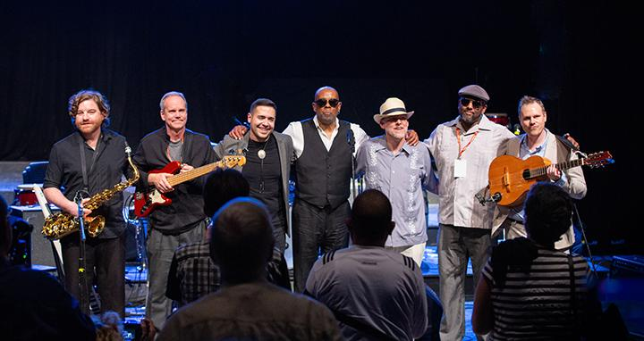 The Cubanisms bow at the end of their performance on Jan 19, at the art center, Fabrica De Arte Cubano. From left to right: James Isaac, Bruno Bessa, Forest Stewart, Miko Spears, Robert Beasley, John Curry and Michael McClintock. (Photo by Brian Compton/For the Muleskinner)