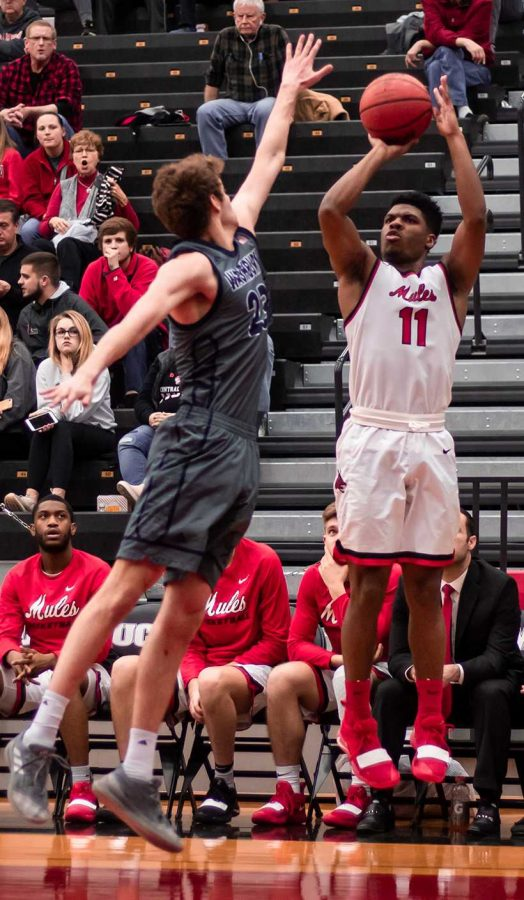 Senior guard Jafar Kinsey attempts a three-pointer in the Mules 74-69 loss to Washburn Feb. 6. Kinsey is averaging 13 points and five rebounds per game this season. Photo by Peter Spexarth/For the Muleskinner