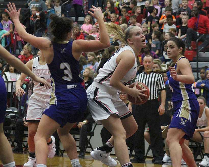 Junior forward Morgan Flemming spins past a defender for a layup in the Jennies 86-74 win over Westminster Nov. 20. Fleming is averaging a career high 13 points and six rebounds per game this season. Photo by Jason Brown/Managing Editor