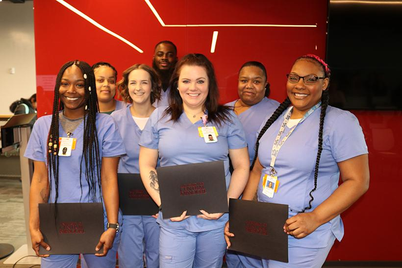 Certified Nursing Associate graduates holding their certificates on Feb. 21 at the Missouri Innovation campus. (Photo submitted by Rick Smetana/ For the Muleskinner)