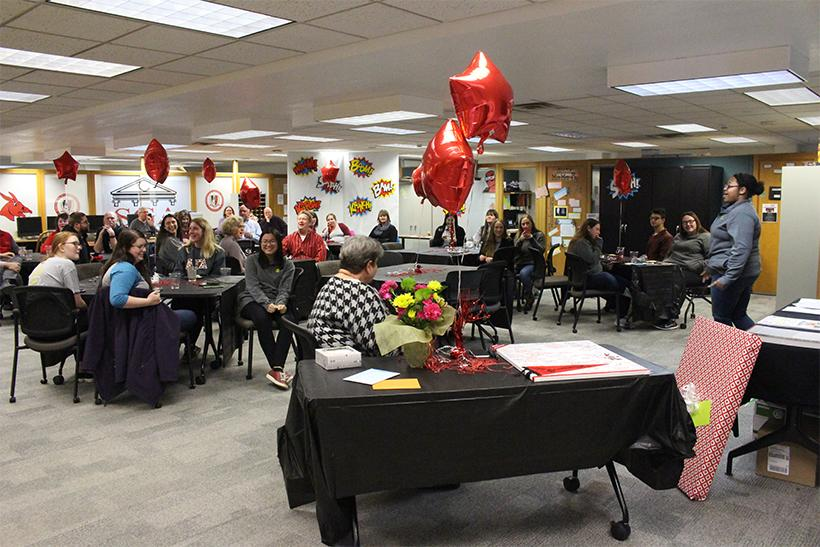 Students, friends and coworkers gather, in the Student Activities office, to celebrate the work and talents that Emily Bergsieker has brought to UCM. (Photo by Erin Wides/Features Editor)