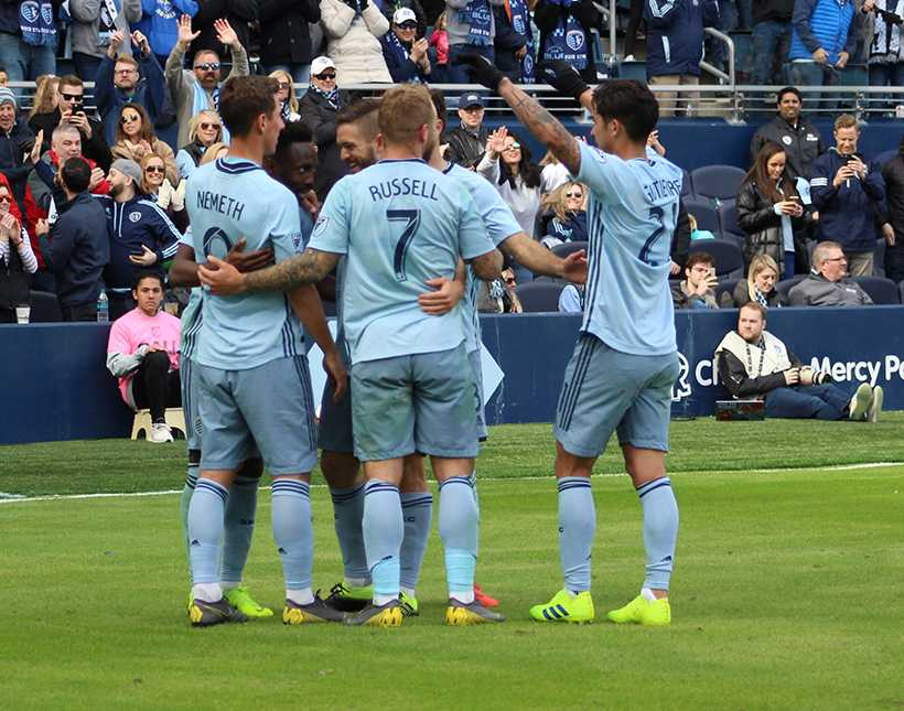 Sporting players huddle in celebration of a goal in the 2-0 win over Philadelphia Union Sunday at Children's Mercy Park. Photo by Jason Brown/Managing Editor